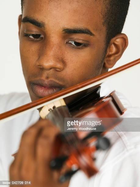 Young man playing a violin