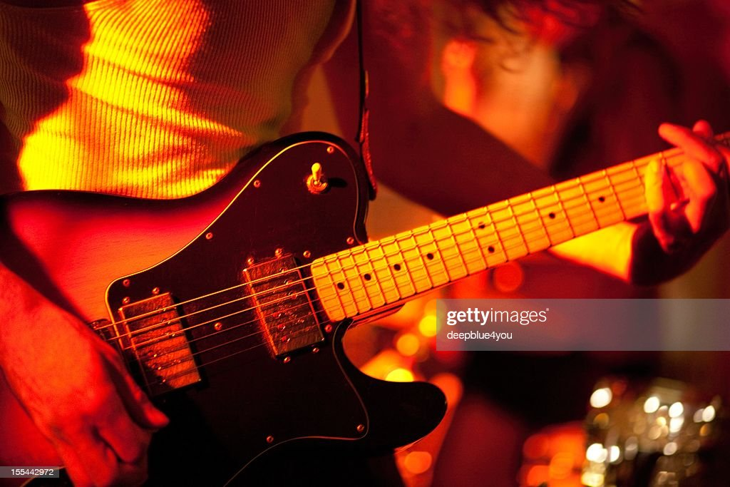 electric guitar player on stage stock photo getty images. Black Bedroom Furniture Sets. Home Design Ideas