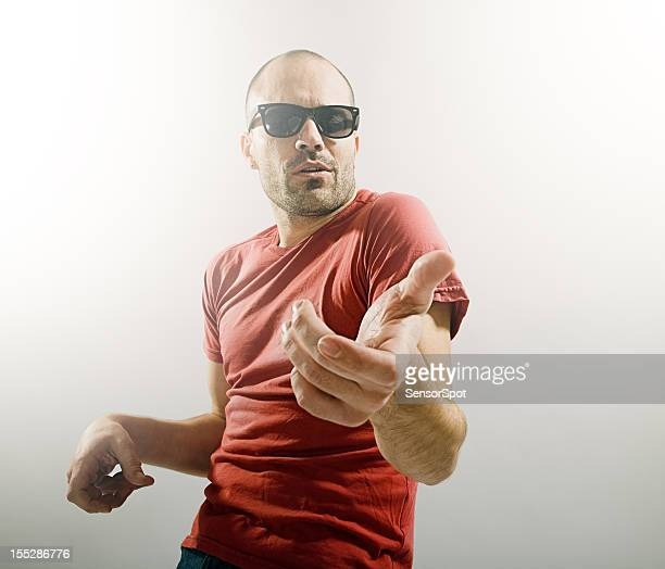 Young man playing air guitar