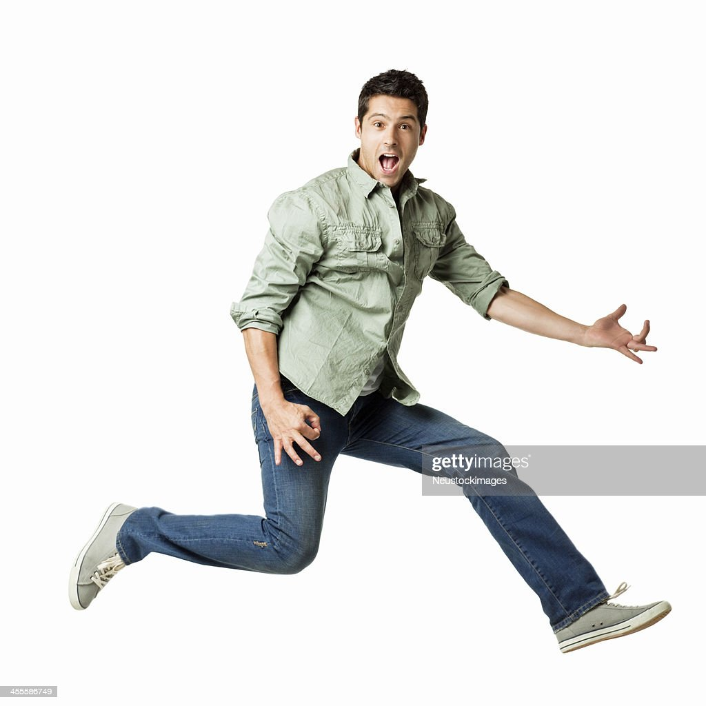 Young Man Playing an Air Guitar - Isolated