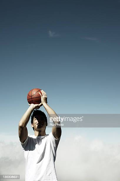 young man playing basketball at the mountain
