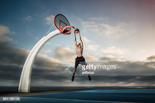 Young man playing basketball in a park, Los Angeles, California, USA