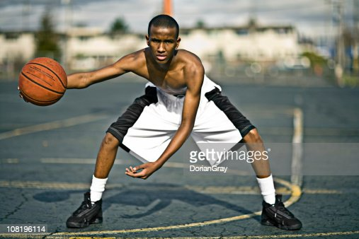 Young Man Playing Basketball on Court Outside : Stock Photo