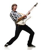 Young man playing electric guitar, shouting