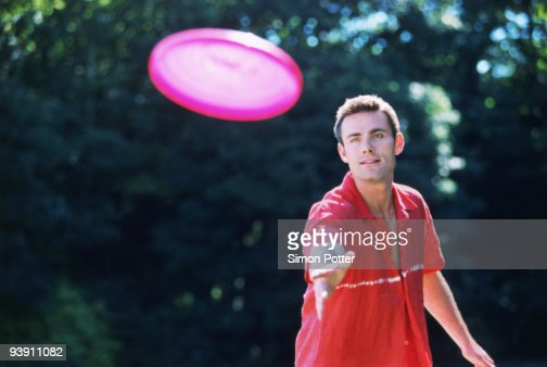A young man playing Frisbee