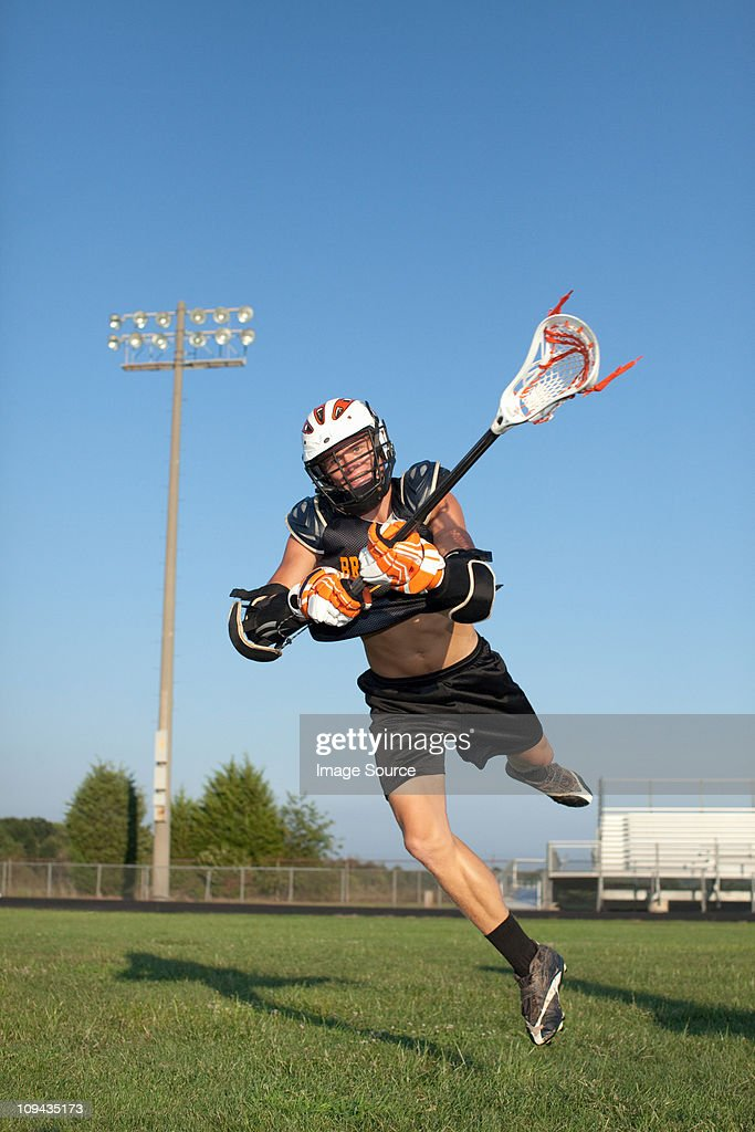 Young man playing lacrosse