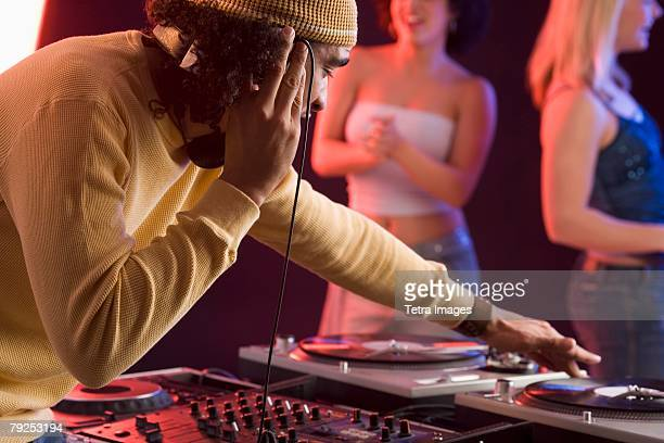 Young man playing music at a dance club