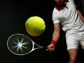 Young man playing tennis, mid section, (digital composite)