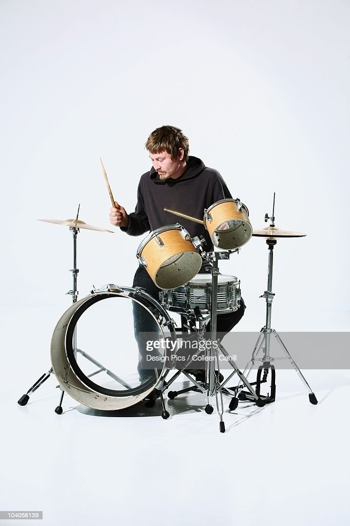 A Young Man Playing The Drums : Stock Photo