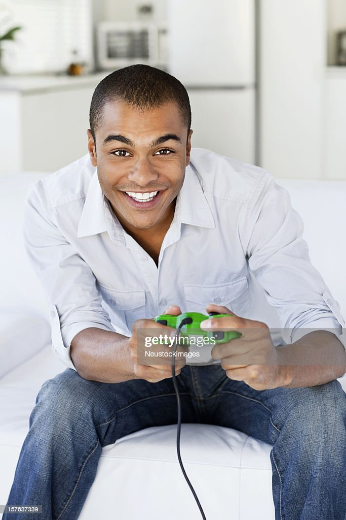 Young Man Playing Video Games : Stock Photo