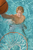 Young man playing water basketball