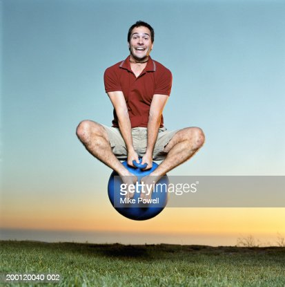 Young man playing with bounce and hop ball
