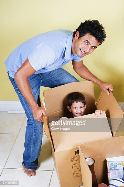 Young man playing with his son