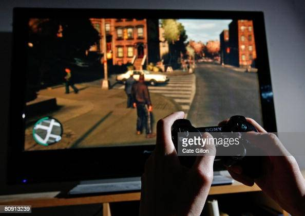 A young man plays Grand Theft Auto IV on the game's day of release on April 29 2008 in London England The game designed for the Playstation 3 was in...