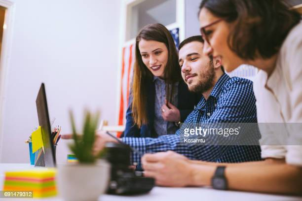 Young Man Pointing Among Women At Stuff Meeting