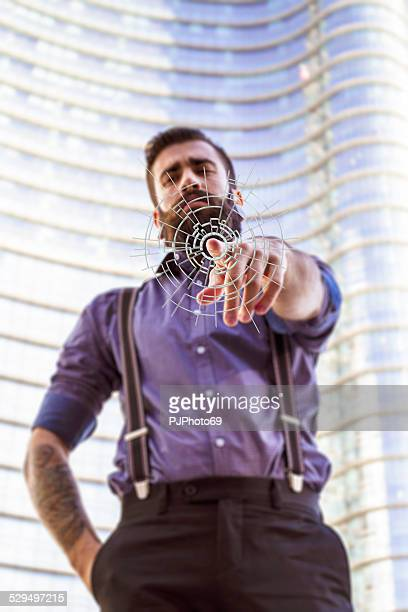 Young man (Hipster style) pointing finger