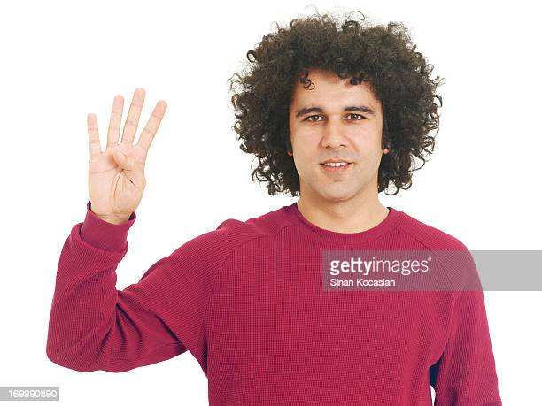 Young man portrait, hand sign four
