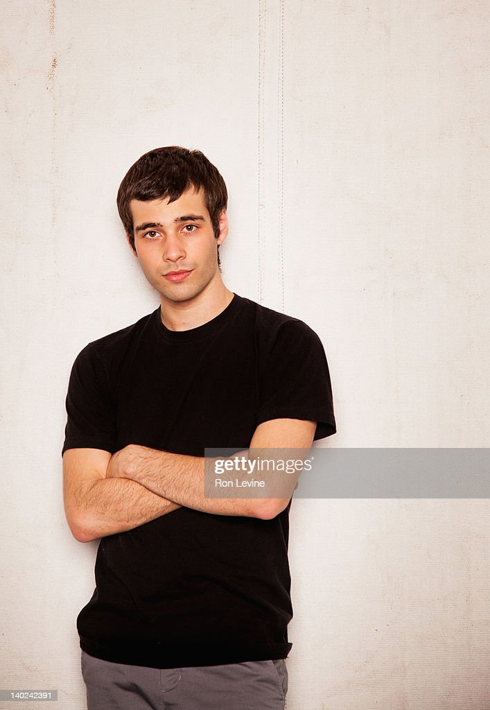 Young man;  portrait with arms crossed : Stock Photo