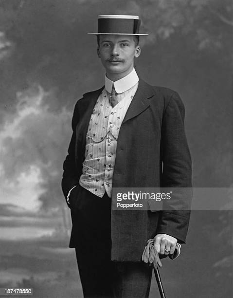 A young man poses for a portrait in a suit worn with a waistcoat and straw boater circa 1905 The picture was taken by photographer Henry Mayson at...