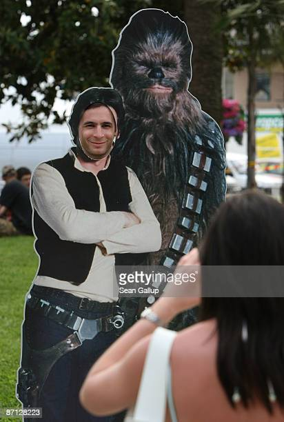 A young man poses for a snapshot as the Star Wars character Han Solo one day prior to the opening of the Cannes International Film Festival on May 12...
