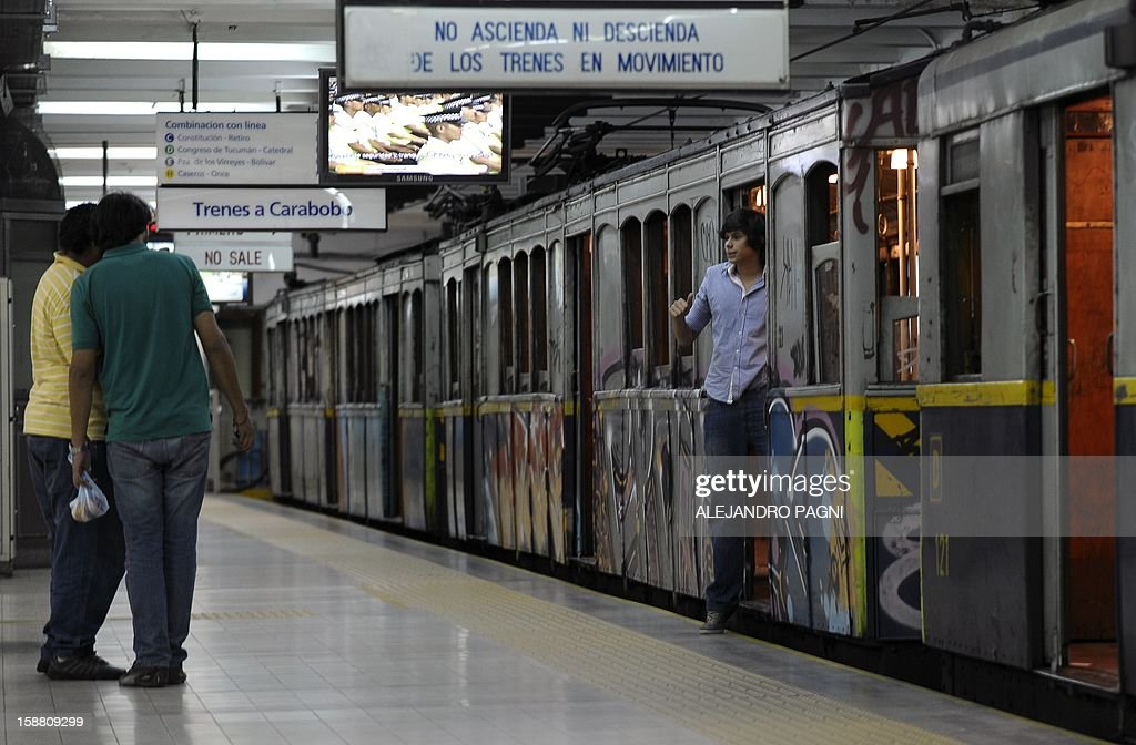 A young man poses in one of the historic wagons of La Brugeoise of the subway Line A which is expected to be close soon following a decision by city mayor Mauricio Macri to replace the fleet with Chinese-made wagons, in Buenos Aires, on December 29, 2012. Line A was the first subway line to work in the southern hemisphere and its trains are among the ten oldest still working daily. The La Brugeoise wagons were constructed between 1912 and 1919 by La Brugeoise et Nicaise et Delcuve in Belgium.