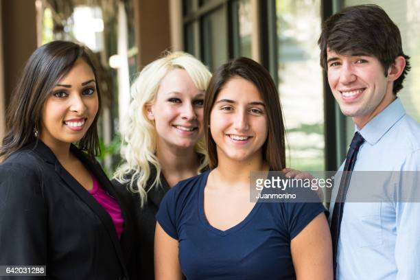 Young man posing with three young women