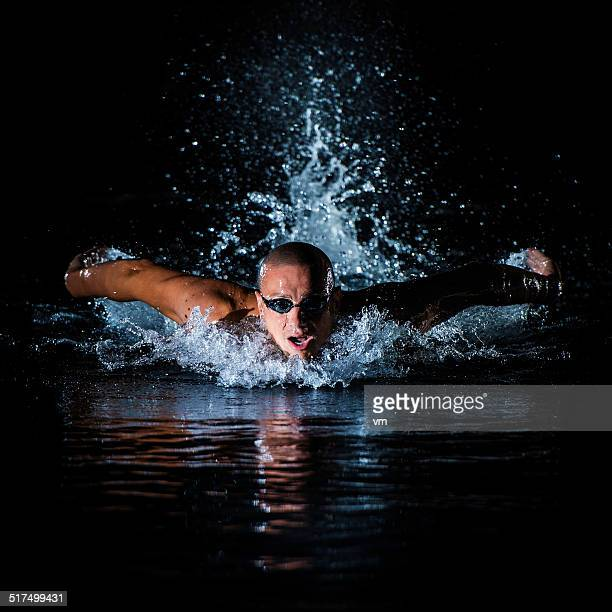 Young Man Practicing Butterfly Stroke