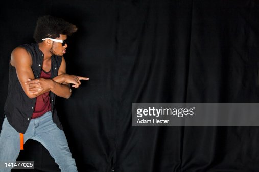 A young man practicing dance in a studio. : Stock Photo