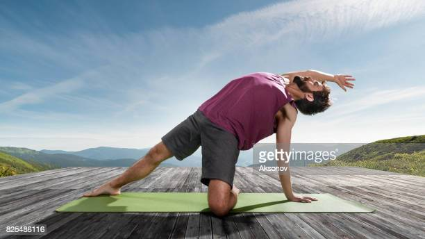 Young man practicing outdoors yoga. Side plank