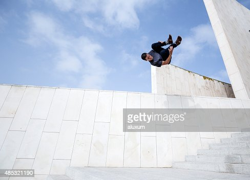 Young man practicing parkour in the city
