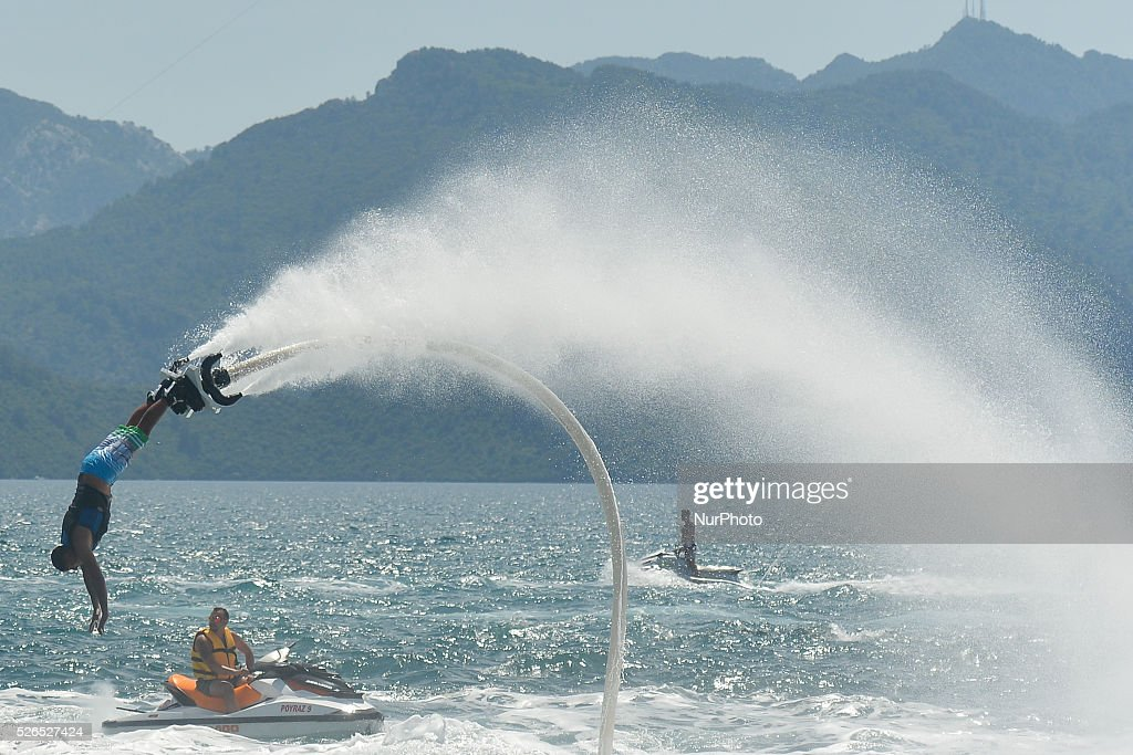 A young man practises a jetboard in Marmaris Harbour during the arrival of the seventh stage of the 52nd Presidential Tour of Turkey 2016, the 128.6 km from Fethiye to Marmaris. On Saturday, 30 April 2016, in Marmaris, Turkey.