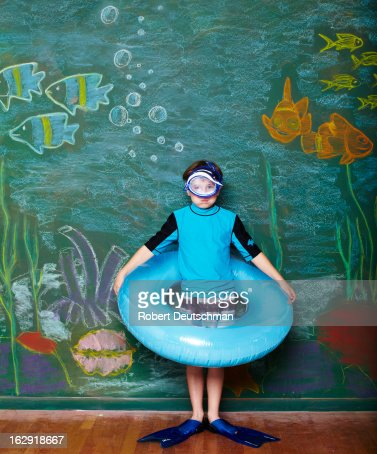 A young man pretending to snorkel. : Stock Photo