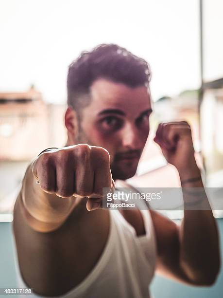 Young Man Pulling A Punch