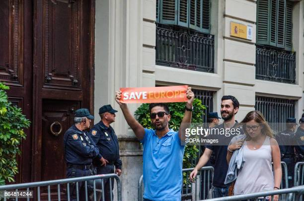A young man raises a sign of support to Europe on its way by the Spanish National Police Central About 450000 people have been focused to support the...