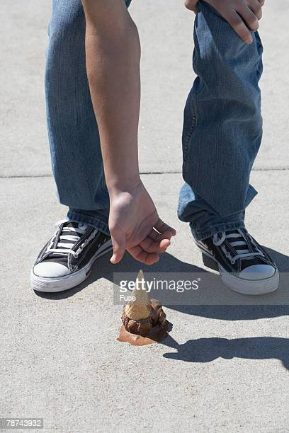 Young Man Reaching for Dropped Ice Cream Cone