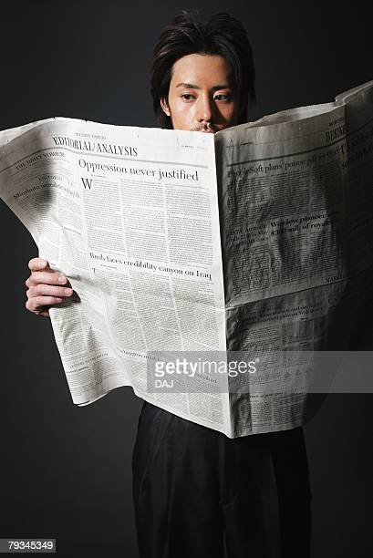 Young Man Reading a Newspaper, Front View