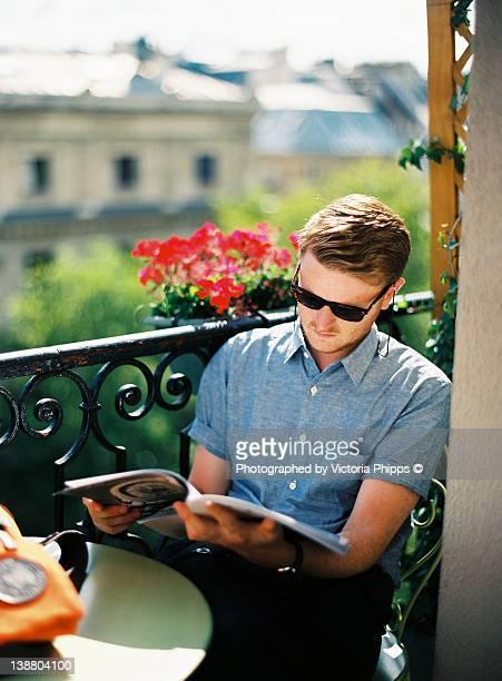 Young man reading magazine