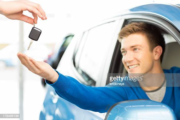 Young Man Receiving Car Key