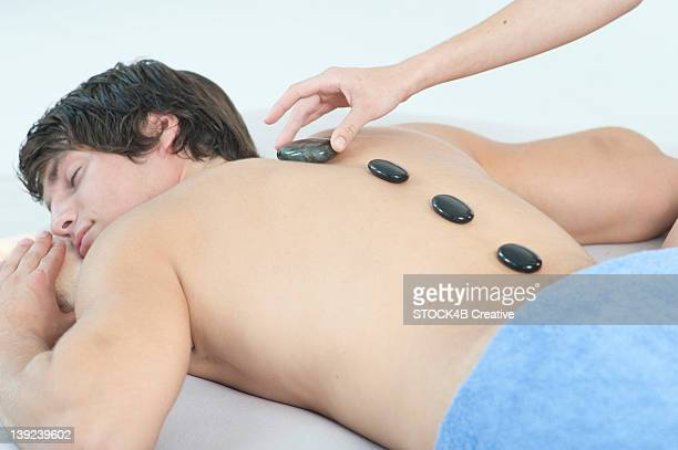 Young man receiving Lastone therapy