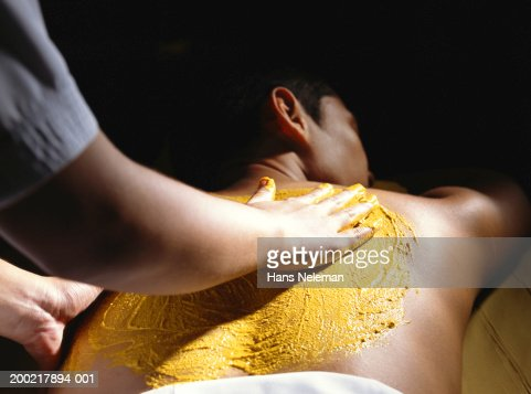 Young man receiving skin treatment at spa, rear view : Stock Photo