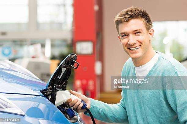 Young Man Refilling Car With Gas Pump