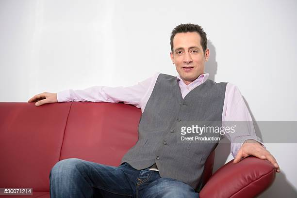 Young man relaxing on sofa waiting portrait