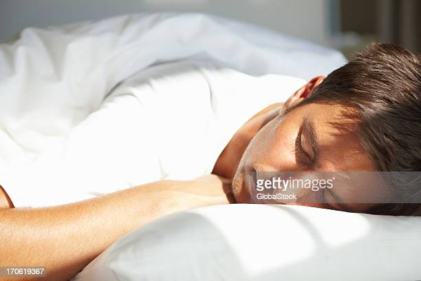 Young man relaxing with eyes closed