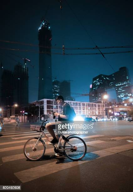 Young man riding a bike on beijing cbd