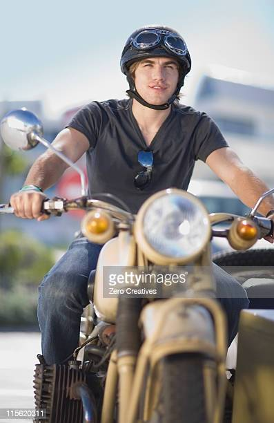 Young man riding a motorbike