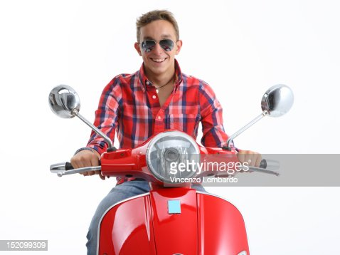 Young Man Riding a Scooter : Stock Photo