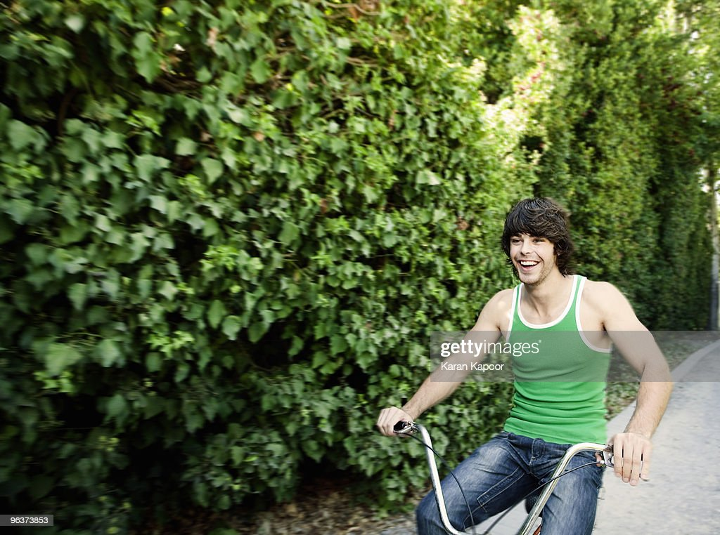 Young man riding cycle : Stock Photo