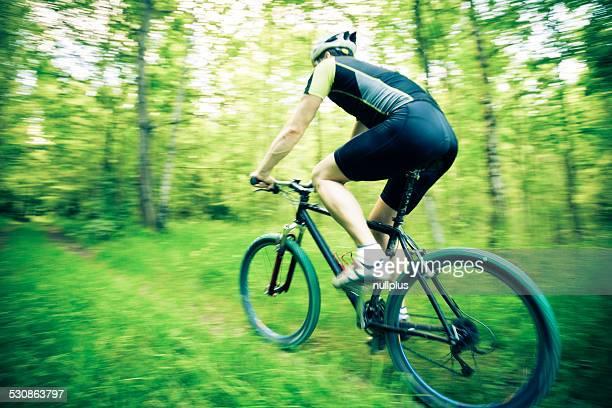 young man riding his mountain bike