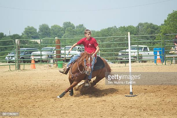 Young Man Riding Horse During Pole Bending