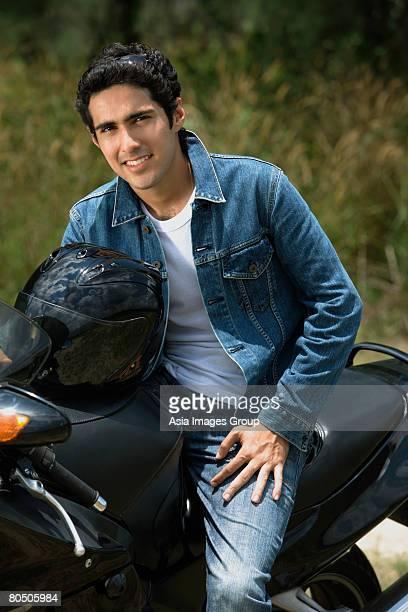 Young man riding motorbike